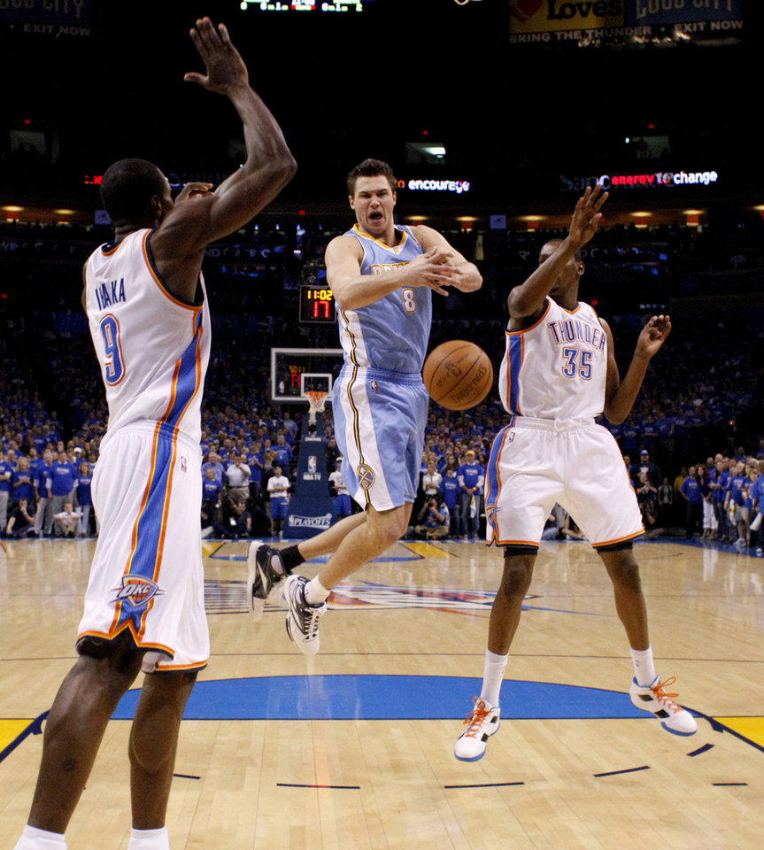 Photo - Denver's Danilo Gallinari (8) loses control of the ball between Oklahoma City's Serge Ibaka (9) and Kevin Durant (35) during the NBA basketball game between the Denver Nuggets and the Oklahoma City Thunder in the first round of the NBA playoffs at the Oklahoma City Arena, Sunday, April 17, 2011. Photo by Bryan Terry, The Oklahoman
