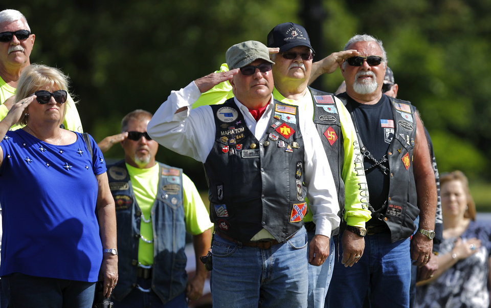 Photo - Veterans salute as the national anthem is played during the 45th Infantry Division Museum's Memorial Day Ceremony on Monday, May 30, 2016. Photo by Jim Beckel, The Oklahoman