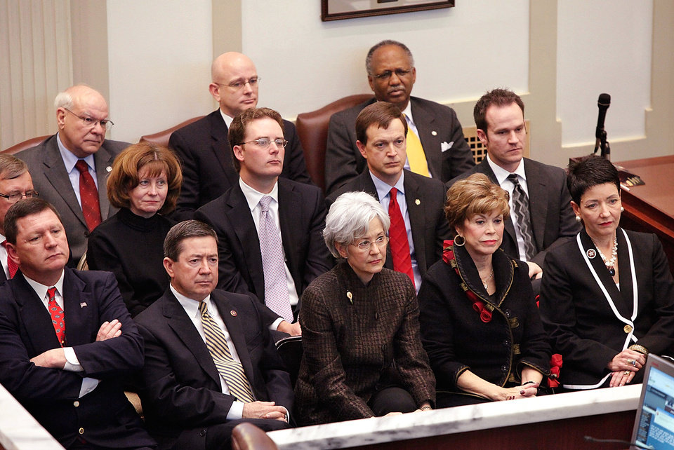 Serious and somber expressions on the faces of the governor\'s cabinet reflect the austere and grim nature of Gov. Brad Henry\'s remarks about the state\'s fiscal condition during his yearly State of the State message to a joint session of lawmakers in the House chambers at the state capitol Monday afternoon, Feb, 1, 2010. Photo by Jim Beckel, The Oklahoman