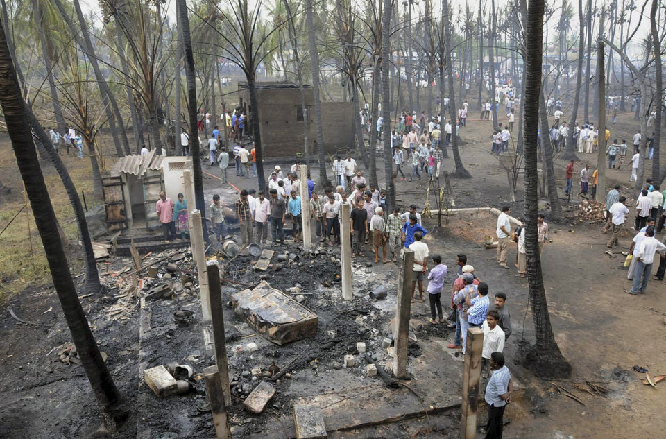 Photo - People gather at the site of a pipeline explosion in Nagaram village, India, Friday, June 27, 2014. A state-owned gas pipeline exploded and burst into flames Friday, killing at least 15 people, destroying homes and forcing the evacuation of neighboring villages in the southern Indian state of Andhra Pradesh, authorities said. (AP Photo)