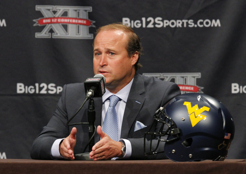 Photo - West Virginia football coach Dana Holgorsen addresses the media during the Big 12 Conference Football Media Days Monday, July 23, 2013 in Dallas.  (AP Photo/Tim Sharp)
