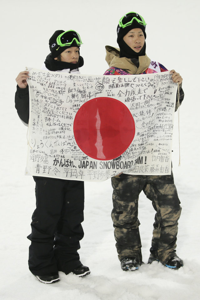 Photo - Japan's silver medalist Ayumu Hirano, left, and bronze medalist Taku Hiraoka pose for photos after the men's snowboard halfpipe final at the Rosa Khutor Extreme Park, at the 2014 Winter Olympics, Tuesday, Feb. 11, 2014, in Krasnaya Polyana, Russia. (AP Photo/Jae C. Hong)