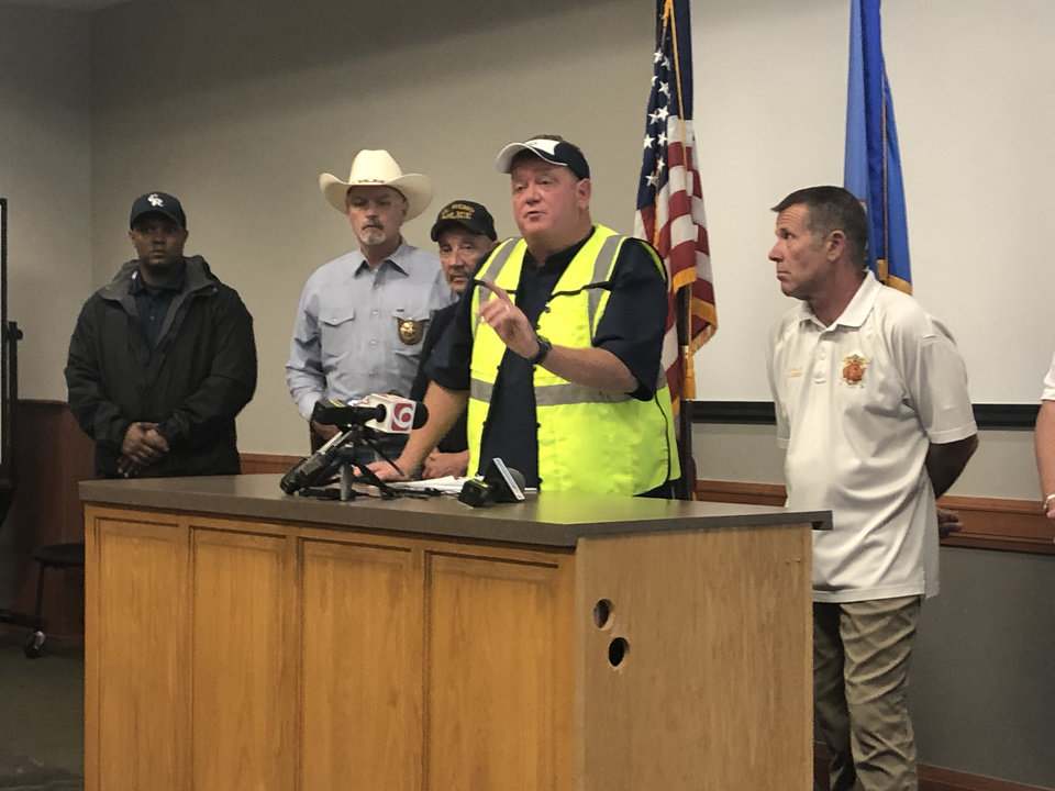 Photo - El Reno Mayor Matt White speaks Sunday morning about the rescue effort underway following a May 25 tornado. [Robert Medley/The Oklahoman]