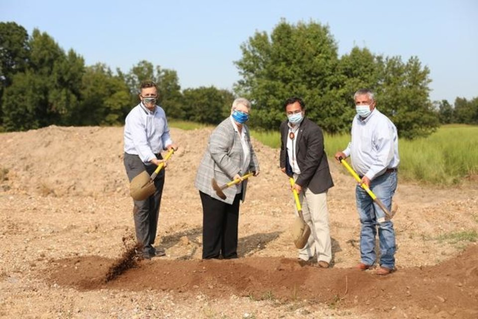 Photo -  From left, Cherokee Chief of Staff Todd Enlow, Cherokee Secretary of State Tina Glory Jordan, Principal Chief Chuck Hoskin Jr. and Tribal Councilor Rex Jordan break ground in Hulbert on Sept. 8 at the future site of a PPE manufacturing facility being funded through the CARES Act. [PHOTO PROVIDED]