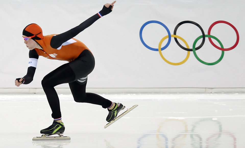 Photo - Jorien ter Mors of the Netherlands skates her way to set a new Olympic record in the women's 1,500-meter race at the Adler Arena Skating Center during the 2014 Winter Olympics in Sochi, Russia, Sunday, Feb. 16, 2014. (AP Photo/Pavel Golovkin)