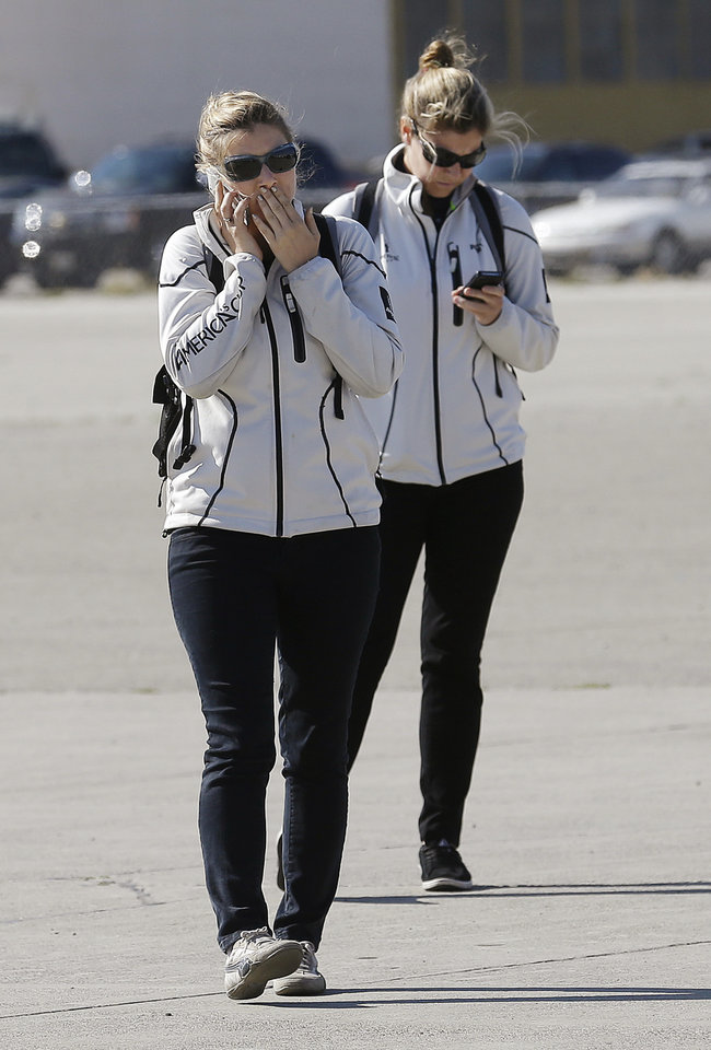 Photo - America's Cup Authority workers Genny Tulloch, left, and Sarah Hawkins walk toward a news conference at the Artemis Racing headquarters in Alameda, Calif., Thursday, May 9, 2013. Artemis Racing said Andrew