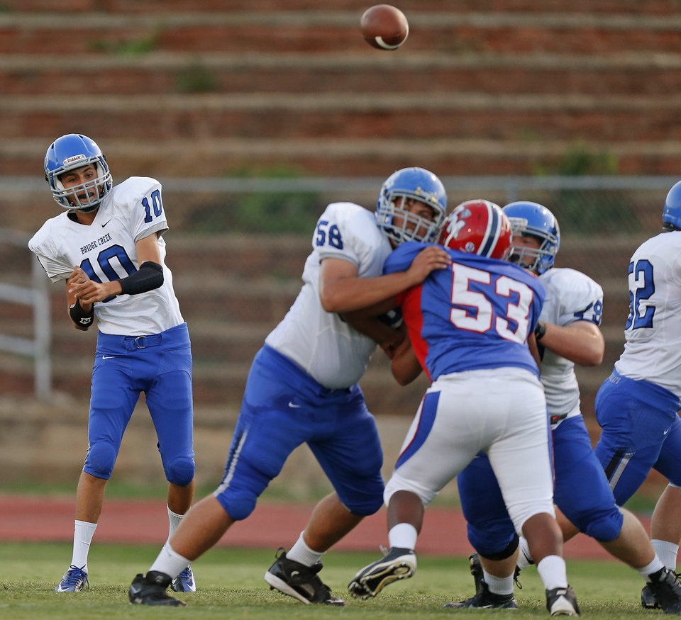 Bridge Creek's Joseph Shells throws a pass against John Marshall during a high school football game at Taft Stadium in Oklahoma City, Thursday, September 6, 2012. Photo by Bryan Terry, The Oklahoman