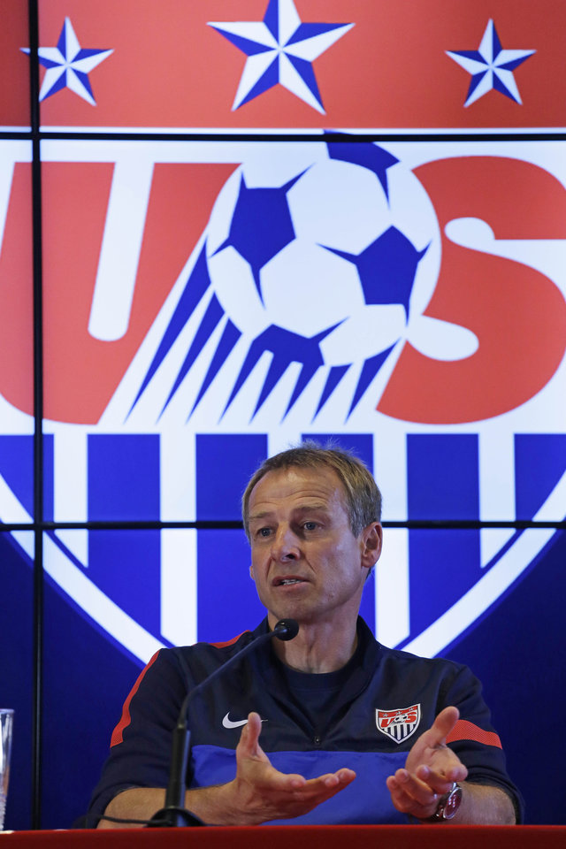 Photo - Head coach of United States soccer team, Jurgen Klinsmann, talks during a press conference after a training session in Sao Paulo, Brazil, Tuesday, Jan. 14, 2014. The US national soccer team is on a training program to prepare for the World Cup tournament that starts in June. (AP Photo/Nelson Antoine)