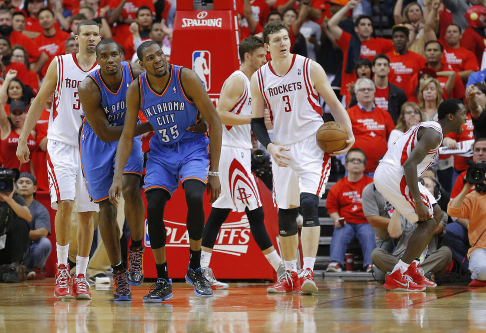 Photo - Oklahoma City's Kevin Durant (35) reacts beside Oklahoma City's Serge Ibaka (9) as Houston's Francisco Garcia (32), and Omer Asik (3) watch after a foul during Game 4 in the first round of the NBA playoffs between the Oklahoma City Thunder and the Houston Rockets at the Toyota Center in Houston, Texas,Sunday, April 29, 2013. Oklahoma City lost 105-103. Photo by Bryan Terry, The Oklahoman