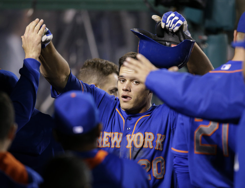Photo - New York Mets' Anthony Recker , center, is congratulated by teammates after hitting a home run during the 13th inning of a baseball game against the Los Angeles Angels on Saturday, April 12, 2014, in Anaheim, Calif. The Mets won 7-6. (AP Photo/Jae C. Hong)