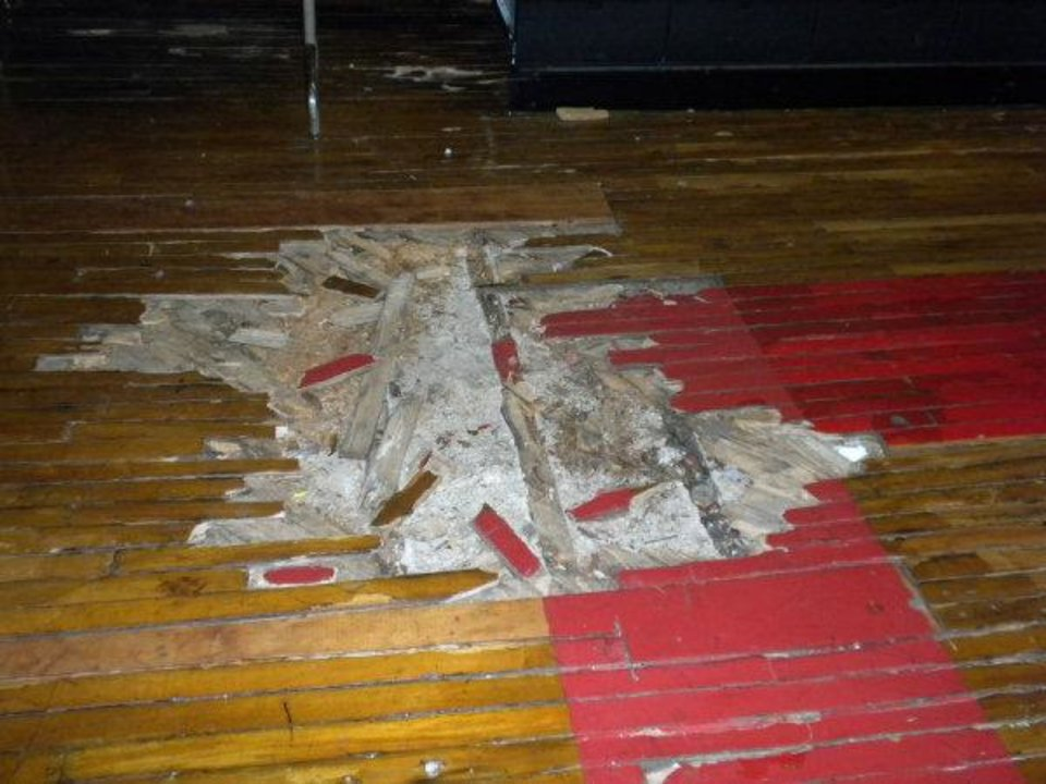 Photo - A busted portion of the gymnasium floor at Taft Middle School, 2901 NW 23, is shown before the damaged parts of the floor were recently replaced by a member of Mayflower United Church of Christ.  Photo provided