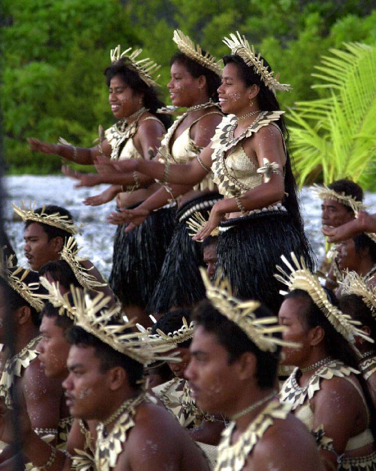 Photo - MILLENNIUM NEW YEAR FESTIVITIES: Kiribati dancers perform to welcome the first sunrise of the new year on Millennium Island, Kiribati, Jan. 1, 2000. (AP Photo/Katsumi Kasahara)