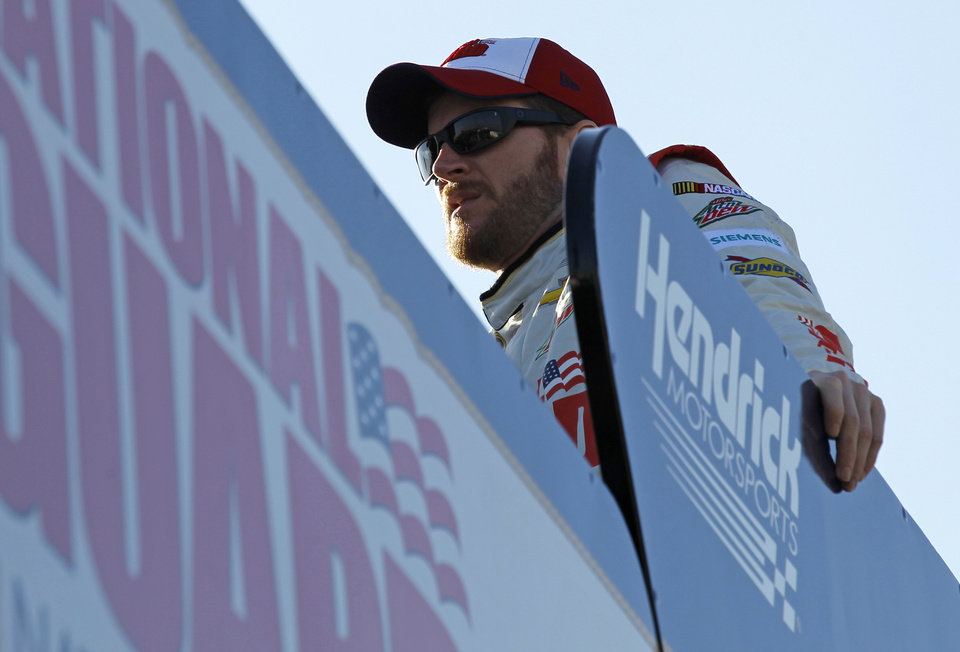 Photo - Dale Earnahrdt Jr. watches from the top of his transporter during practice for Sunday's NASCAR Daytona 500 Sprint Cup Series auto race at Daytona International Speedway in Daytona Beach, Fla., Wednesday, Feb. 19, 2014. (AP Photo/Terry Renna)