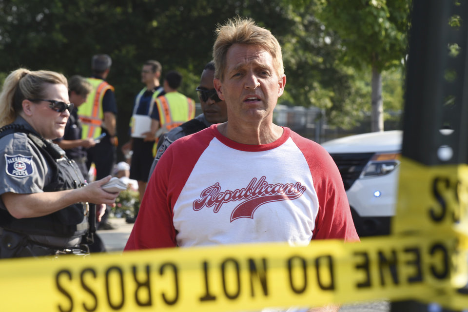 Photo - Sen. Jeff Flake, R-Ariz. walks toward media gathered at the scene of a shooting at a baseball field in Alexandria, Va., Wednesday, June 14, 2017, during a Congressional baseball practice where House Majority Whip Steve Scalise of La. was shot. (AP Photo/Kevin S. Vineys)