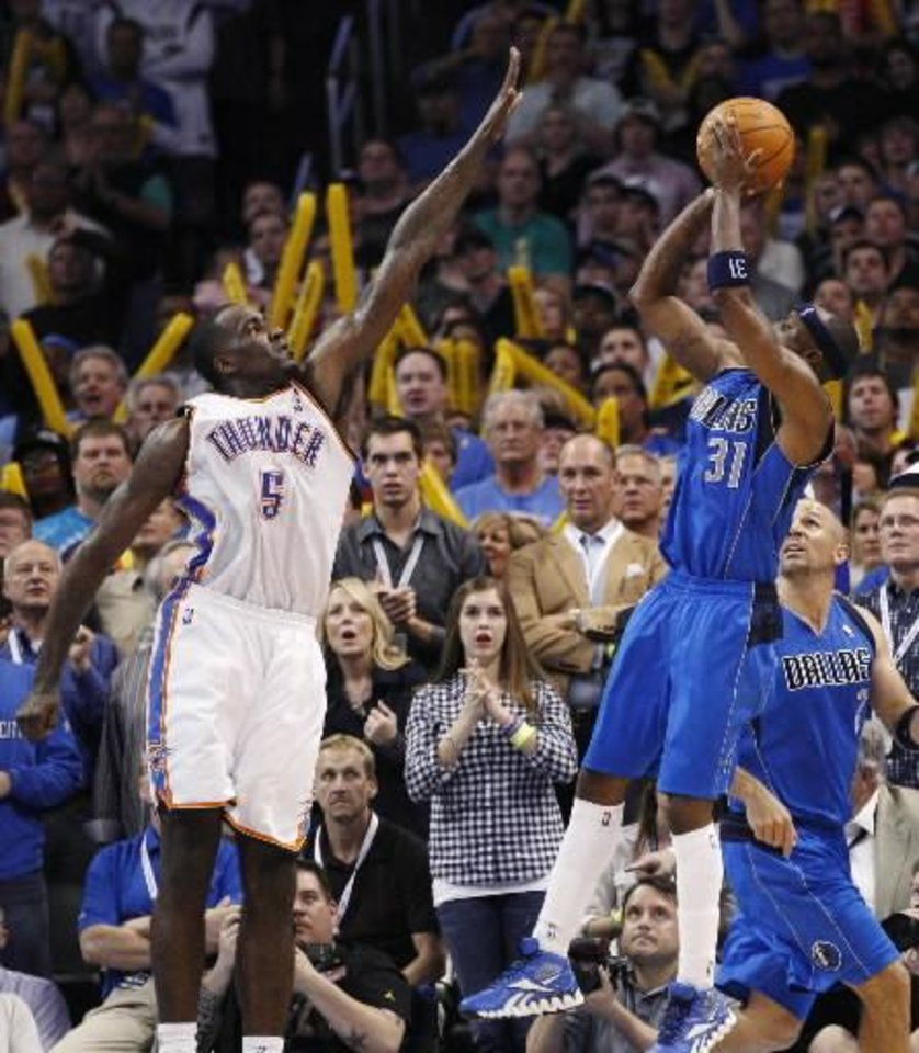 Thunder center Kendrick Perkins, left, defends Dallas guard Jason Terry last in the fourth quarter during OKC\'s 95-91 victory Monday night at Chesapeake Energy Arena.