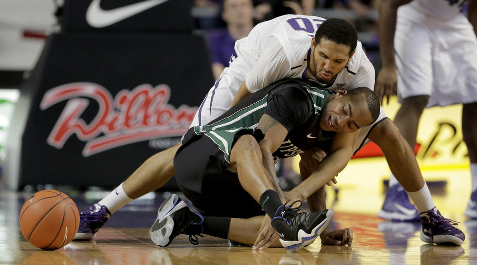 Photo - Kansas State forward Adrian Diaz (20) knocks the ball away from South Carolina Upstate forward Rob Elam, bottom, during the first half of an NCAA college basketball game on Sunday, Dec. 2, 2012, in Manhattan, Kan. (AP Photo/Charlie Riedel)