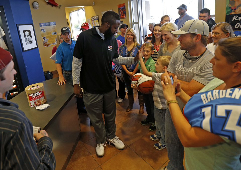 James Harden of the Oklahoma City Thunder greets fans at the new Raising Cane's in Edmond, Thursday, September 27, 2012. Photo by Bryan Terry, The Oklahoman