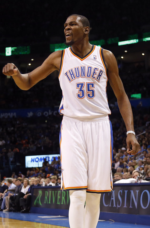 Photo - Oklahoma City's Kevin Durant (35) reacts to a call by the officials during the NBA basketball game between the Oklahoma City Thunder and the Cleveland Cavaliers at the Chesapeake Energy Arena in Oklahoma City, Okla. on Wednesday, Feb. 26, 2014.  Photo by Chris Landsberger, The Oklahoman