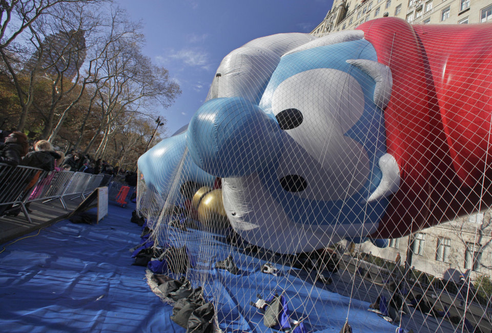 Photo -   The new Papa Smurf balloon is restrained under netting after it was inflated for the 86th annual Macy's Thanksgiving Day Parade, on New York's Upper West Side, Wednesday, Nov. 21, 2012. More than 3 million people typically attend the event and it has a TV audience of 50 million. (AP Photo/Richard Drew)
