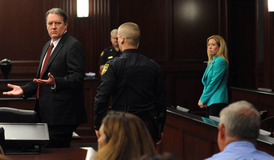 Photo - Michael Dunn reacts after the verdict is read in Jacksonville, Fla., Saturday, Feb. 15, 2014. Dunn was convicted of attempted murder in the shooting death of a teenager over an argument over loud music, but jurors could not agree on the most serious charge of first-degree murder. (The Florida Times-Union, Bob Mack, Pool)