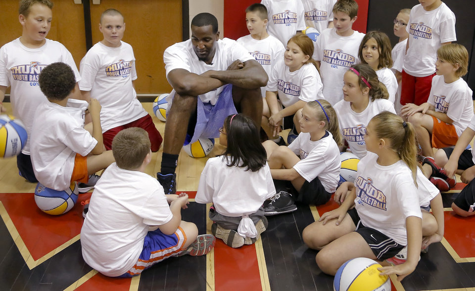 Oklahoma City Thunder's Kendrick Perkins talks with the participants in the Oklahoma City Thunder basketball camp at Mid-America Christian University on Wednesday, June 19, 2013 in Oklahoma City, Okla.   Photo by Chris Landsberger, The Oklahoman