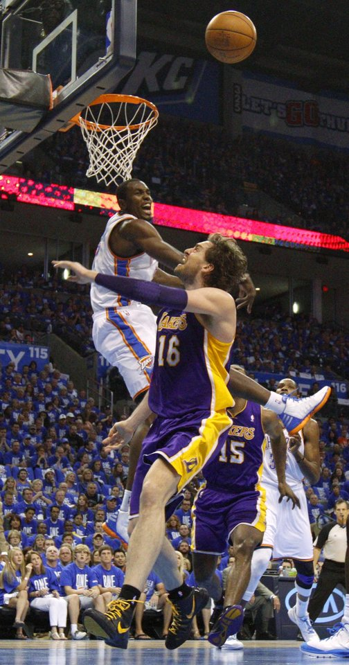Oklahoma City\'s Serge Ibaka (9) blocks the shot of Los Angeles\' Pau Gasol (16) during Game 1 in the second round of the NBA playoffs between the Oklahoma City Thunder and L.A. Lakers at Chesapeake Energy Arena in Oklahoma City, Monday, May 14, 2012. Photo by Bryan Terry, The Oklahoman