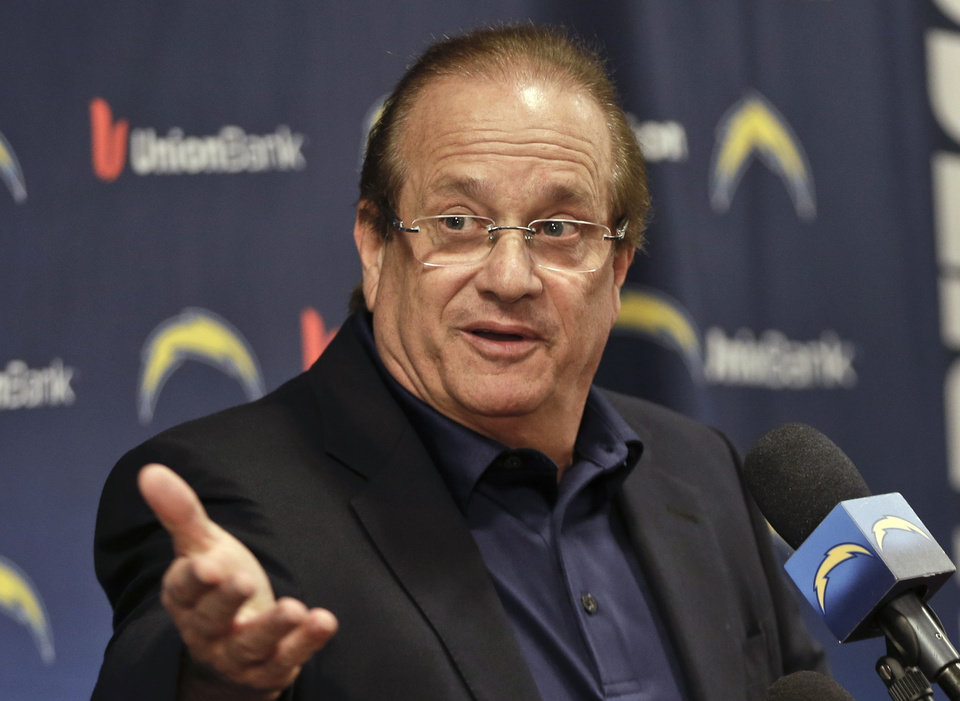 Photo - Dean Spanos, San Diego Chargers president, talks about the firing of coach Norv Turner and general manager A.J. Smith on Monday, Dec. 31, 2012, in San Diego. Despite having what was perceived as one of the NFL's most-talented rosters for several seasons, Smith and Turner never got the Chargers to the Super Bowl. (AP Photo/Lenny Ignelzi)