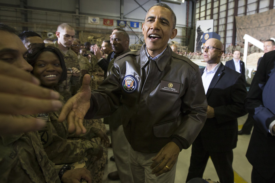 Photo - President Barack Obama shakes hands during a troop rally at Bagram Air Field during an unannounced visit, on Sunday, May 25, 2014, north of Kabul, Afghanistan. (AP Photo/ Evan Vucci)