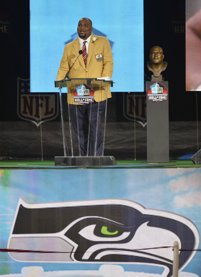 Photo - Hall of Fame inductee Walter Jones speaks during the Pro Football Hall of Fame enshrinement ceremony Saturday, Aug. 2, 2014, in Canton, Ohio. (AP Photo/David Richard)