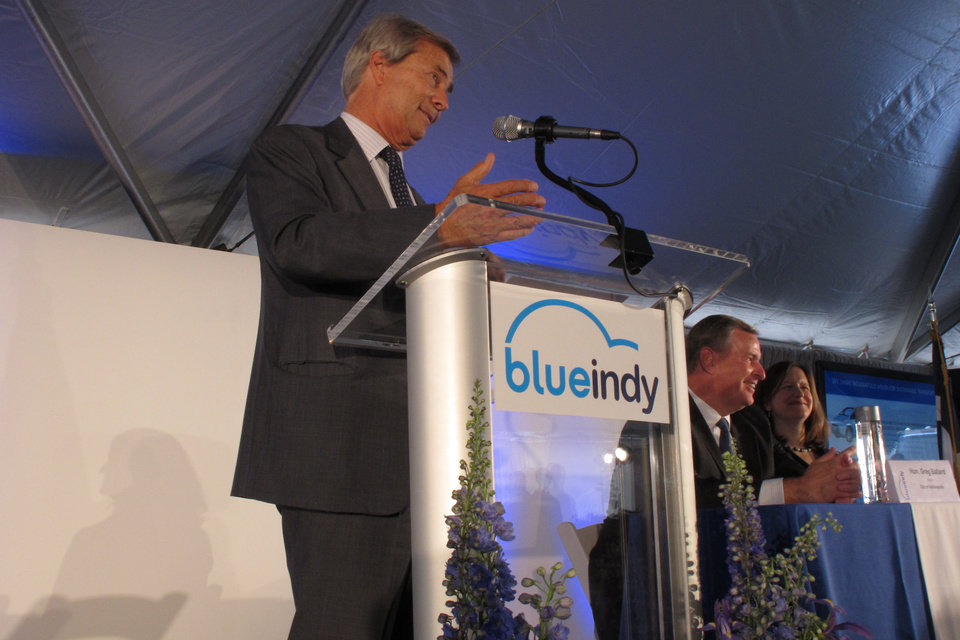 Photo - Bollore Group Chairman Vincent Bollore speaks on Monday, May 19, 2014, during a reception after the French company debuted an electric car-charging station in downtown Indianapolis. Indianapolis Mayor Greg Ballard is to Bollore's left, and on his left is Kelly Huntington, the CEO of Indianapolis Power & Light Co. The car-charging station is part of an electric car-sharing service coming to Indiana's capital. Bollore Group is investing $35 million in the project that won't be up and running until year's end, when 125 cars will be available at 25 charging sites around the city. (AP Photo/Rick Callahan)