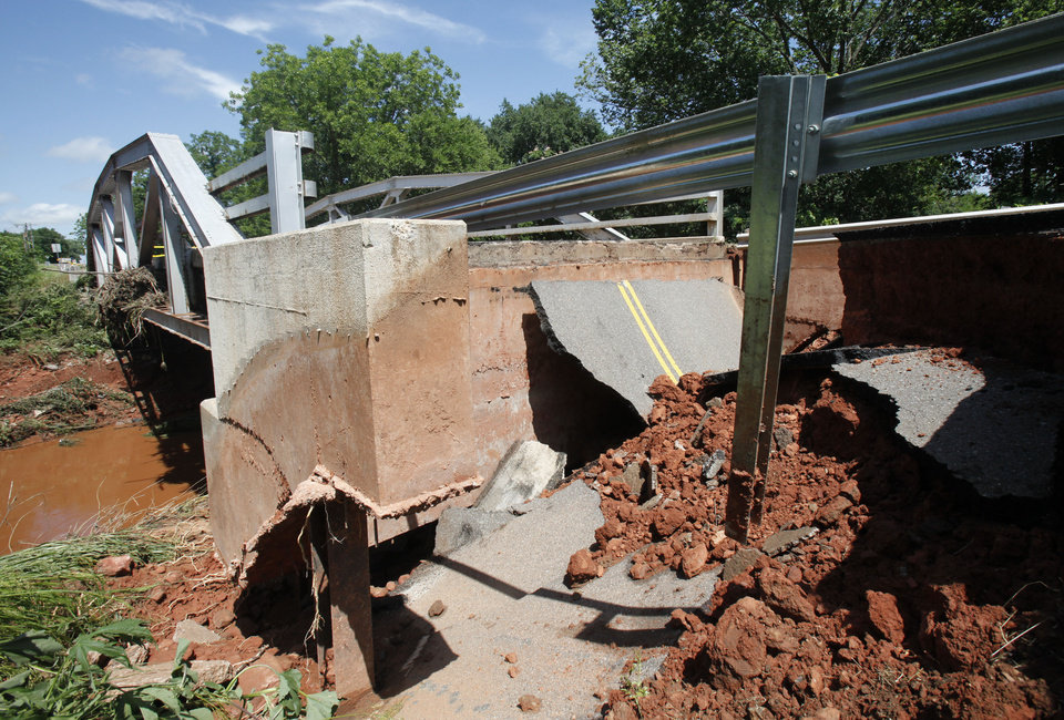 This bridge on Sorghum Mill Rd. between Santa Fe and Western in Edmond, OK, has been washed out by yesterday's torential rains, Tuesday, June 15, 2010. By Paul Hellstern, The Oklahoman