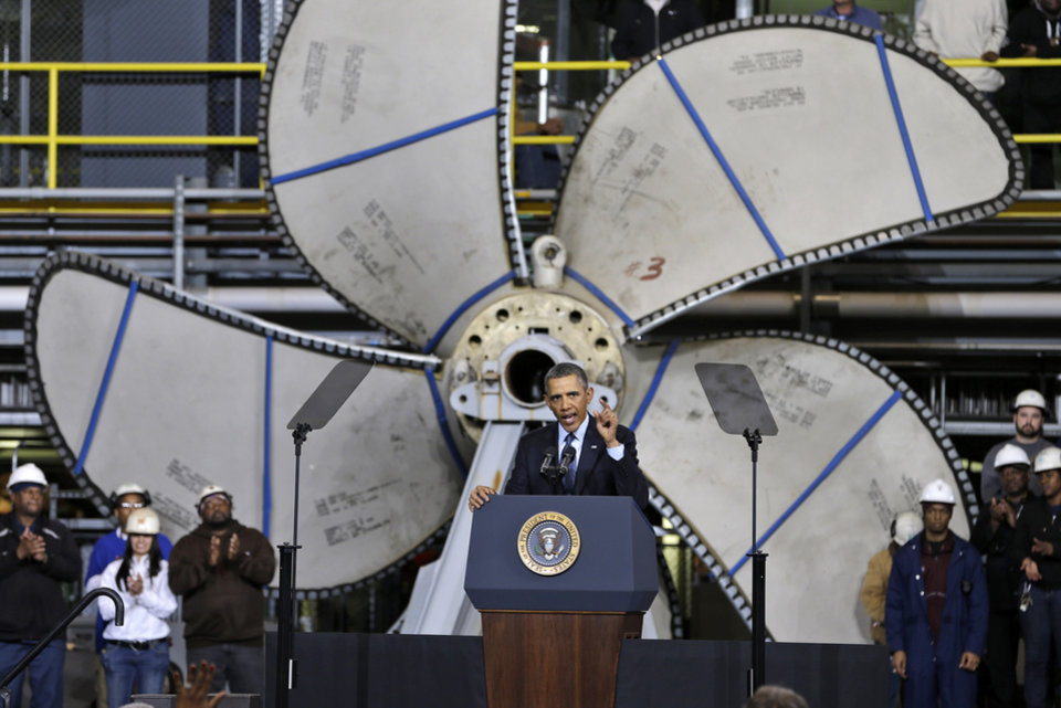 Photo - Standing in front of a ships propeller, President Barack Obama, gestures during a speech about automatic defense budget cuts, Tuesday, Feb. 26, 2013, at Newport News Shipbuilding in Newport News, Va.  (AP Photo/Steve Helber)