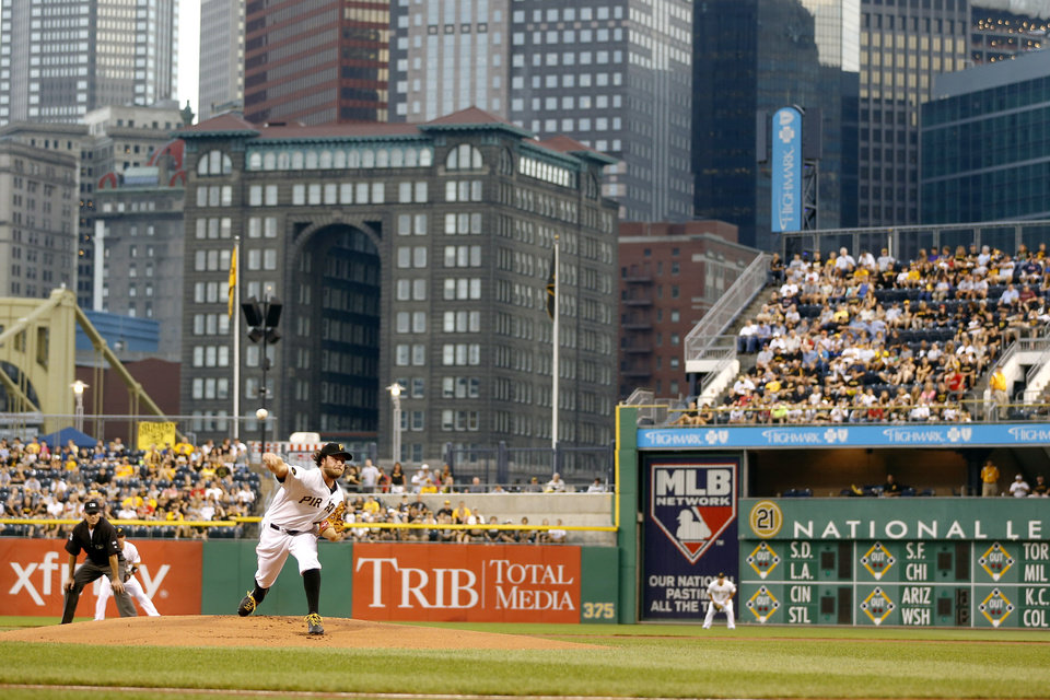 Photo - Pittsburgh Pirates starting pitcher Gerrit Cole throws against the Atlanta Braves in the first inning of the baseball game on Wednesday, Aug. 20, 2014, in Pittsburgh. This was Cole's first major league start since going on the injured reserve list. (AP Photo/Keith Srakocic)