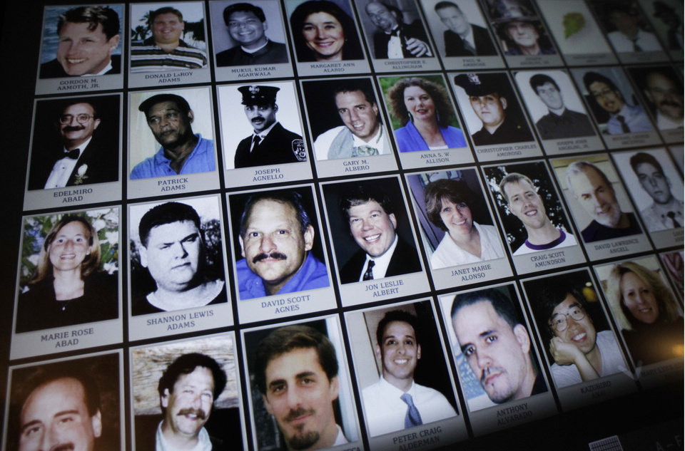 Photo - FILE - This Sept. 10, 2012 file photo shows electronic images of victims of the attacks of Sept. 11, 2001, destined to be a part of the future 9/11 Memorial Museum, during a news conference in New York. The museum will be dedicated in a ceremony attended by President Barack Obama on Thursday, May 15, 2014. It will open to the public May 21. (AP Photo/Mark Lennihan, File)
