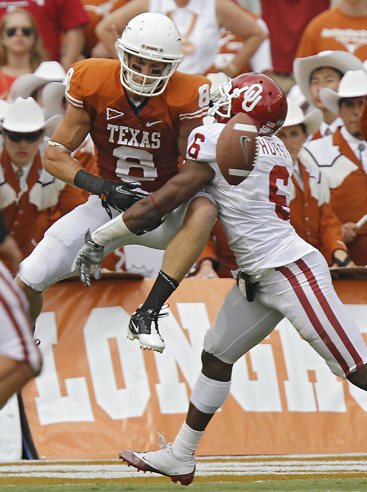 Oklahoma's Demontre Hurst (6) breaks up a pass for Texas' Jaxon Shipley (8) during the Red River Rivalry college football game between the University of Oklahoma Sooners (OU) and the University of Texas Longhorns (UT) at the Cotton Bowl in Dallas, Saturday, Oct. 8, 2011. Photo by Chris Landsberger, The Oklahoman