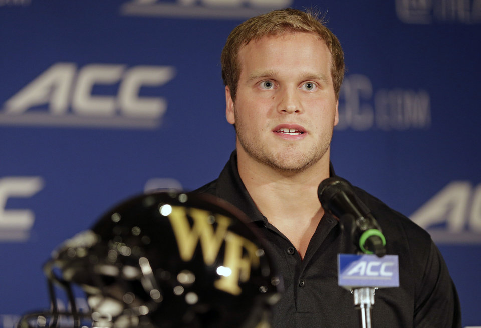 Photo - Wake Forest's Jordan Garside answers a question during a news conference at the Atlantic Coast Conference Football kickoff in Greensboro, N.C., Sunday, July 20, 2014. (AP Photo/Chuck Burton)