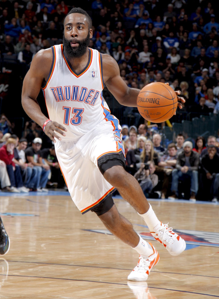 Oklahoma City Thunder's James Harden (13) drives up court during the opening day NBA basketball game between the Oklahoma CIty Thunder and the Orlando Magic at Chesapeake Energy Arena in Oklahoma City, Sunday, Dec. 25, 2011. Photo by Sarah Phipps, The Oklahoman