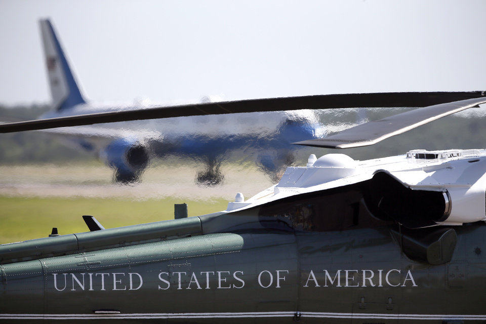 Photo - The exhaust from Marine One causes a blurred view of Air Force One as it taxis to a parking spot carrying President Barack Obama at the North Texas Regional Airport in Denison, Texas, Wednesday, July 15, 2015. (AP Photo/Tony Gutierrez)
