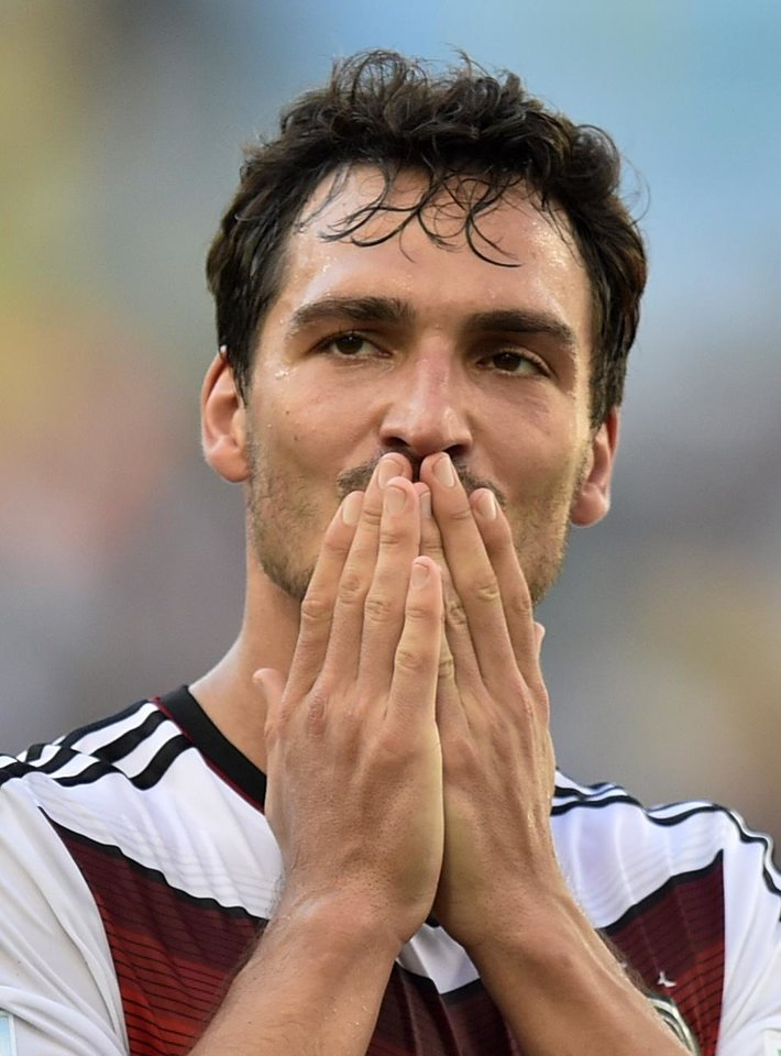 Photo - Germany's Mats Hummels blows a kiss at the end of  the World Cup quarterfinal soccer match between Germany and France at the Maracana Stadium in Rio de Janeiro, Brazil, Friday, July 4, 2014. Germany won the match 1-0.  (AP Photo/Martin Meissner)