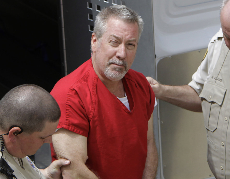 Photo - FILE - In this May 8, 2009 file photo, former Bolingbrook, Ill., police sergeant Drew Peterson arrives at the Will County Courthouse in Joliet, Ill., for his arraignment on charges of first-degree murder in the 2004 death of his former wife Kathleen Savio, who was found in an empty bathtub at home. Peterson's wisecracking, limelight-hogging, sunglasses-wearing lawyers faced the media horde every day of the former suburban Chicago police officer's 2012 trial — one that ended with a murder conviction and a falling out among the erstwhile colleagues. But the lawyerly war of words in public between lead trial counsel Joel Brodsky and former partner-turned-nemesis Steve Greenberg that began within hours of the trial's end will come to a head Tuesday, Feb. 19, 2013 at a hearing where the defense will argue Peterson deserves a new trial because Brodsky did a shoddy job. (AP Photo/M. Spencer Green, File)