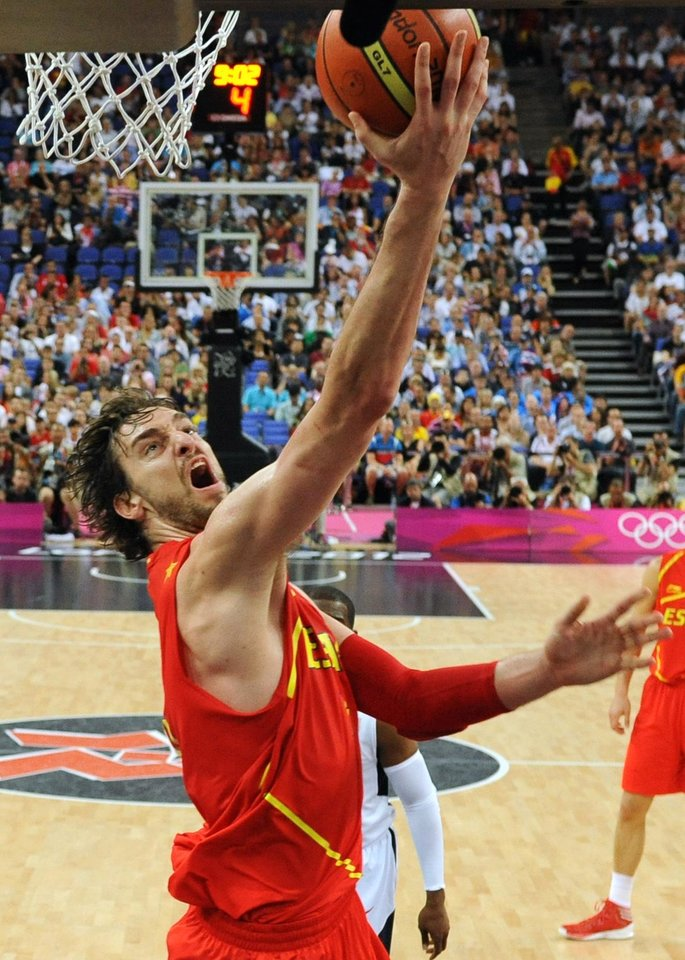 Spain's Pau Gasol shoots to score against the United States during the men's gold medal basketball game at the 2012 Summer Olympics  in London on Sunday, Aug. 12, 2012. (AP Photo/Mark Ralston, Pool)