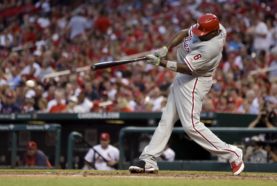Photo - Philadelphia Phillies' Ryan Howard hits an RBI-single during the fourth inning of a baseball game against the St. Louis Cardinals, Thursday, June 19, 2014, in St. Louis. (AP Photo/Jeff Roberson)