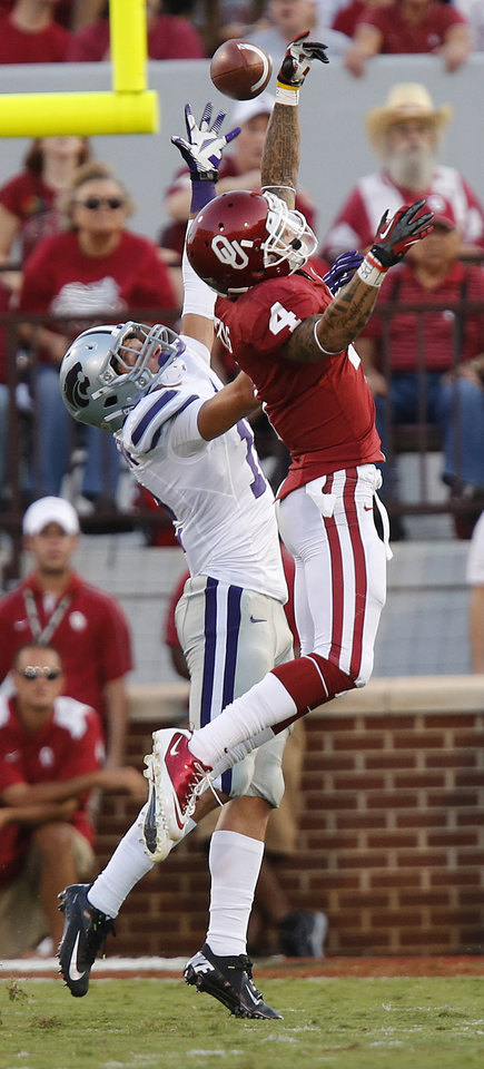 Oklahoma\'s Kenny Stills (4) has a pass broken up by Kansas State\'s Ty Zimmerman (12) during the college football game between the University of Oklahoma Sooners (OU) and the Kansas State University Wildcats (KSU) at the Gaylord Family-Memorial Stadium on Saturday, Sept. 22, 2012, in Norman, Okla. Photo by Chris Landsberger, The Oklahoman