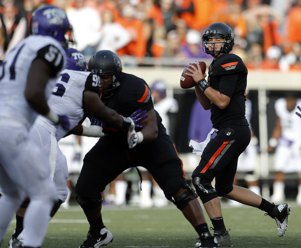 Photo - Oklahoma State's Wes Lunt (11)  looks to throw a pass during a college football game between Oklahoma State University (OSU) and Texas Christian University (TCU) at Boone Pickens Stadium in Stillwater, Okla., Saturday, Oct. 27, 2012. Photo by Sarah Phipps, The Oklahoman