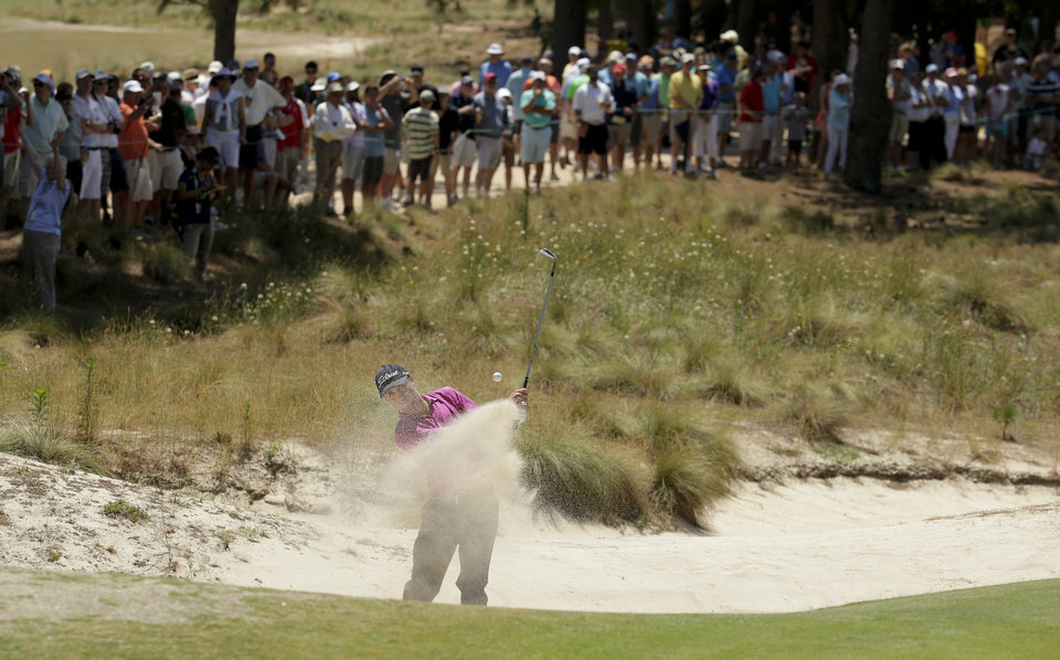 Photo - Justin Thomas hits out of a bunker on the 16th hole during a practice round for the U.S. Open golf tournament in Pinehurst, N.C., Tuesday, June 10, 2014. The tournament starts Thursday. (AP Photo/Charles Riedel)