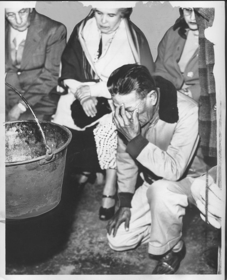 This 1953 photo shows Qua-qua-na-pe-quat, also known as Thomas Brown, kneeling before a campfire and praying in the ancient language of the Ah-tha-Koe-wah, or Sac and Fox, for the spirit of Wa-to-Huk, also known as Jim Thorpe. OKLAHOMAN ARCHIVE PHOTO