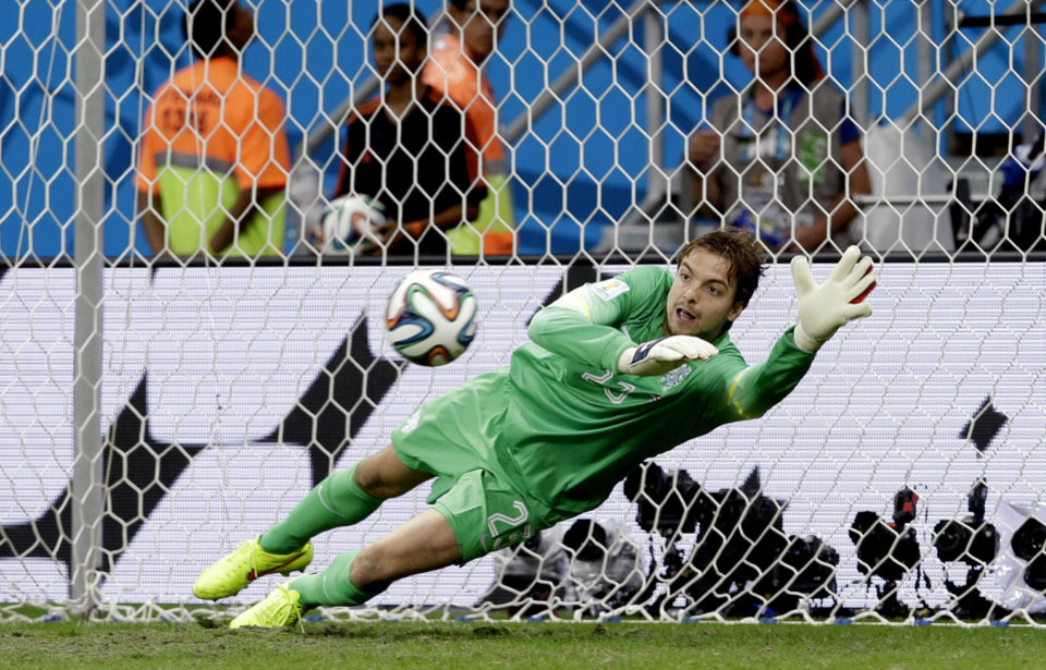 Photo - Netherlands' goalkeeper Tim Krul saves a penalty kick during the World Cup quarterfinal soccer match between the Netherlands and Costa Rica at the Arena Fonte Nova in Salvador, Brazil, Saturday, July 5, 2014. The Netherlands won 4-3 on penalty kicks. (AP Photo/Hassan Ammar)