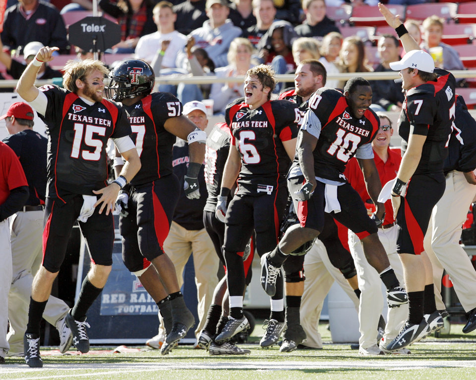 Photo - From left, Texas Tech's Taylor Potts (15), Brian Duncan (57), Austin Zouzalik (6), Harrison Jeffers (10) and Seth Doege (7)  jump on the sidelines as the song