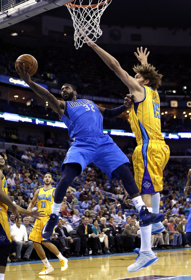 Dallas Mavericks guard O.J. Mayo (32) drives to the basket against New Orleans Hornets center Robin Lopez (15) during the first half of an NBA basketball game in New Orleans, Friday, Feb. 22, 2013. (AP Photo/Gerald Herbert)