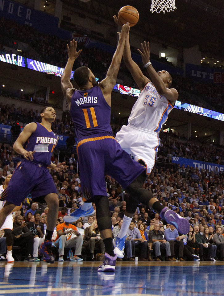 Oklahoma City Thunder small forward Kevin Durant (35) goes to the basket beside Phoenix Suns power forward Markieff Morris (11) during an NBA basketball game between the Oklahoma City Thunder and the Phoenix Suns at Chesapeake Energy Arena in Oklahoma City, Sunday, Nov. 3, 2013. Photo by Bryan Terry, The Oklahoman